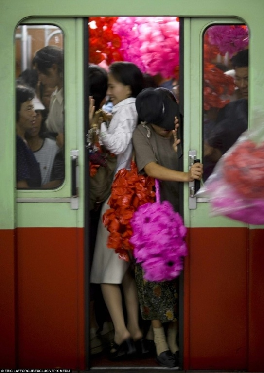 4328BFE700000578-4781398-Rush_hour_Residents_try_to_close_the_door_of_a_packed_train_alon-a-3_1502445979803